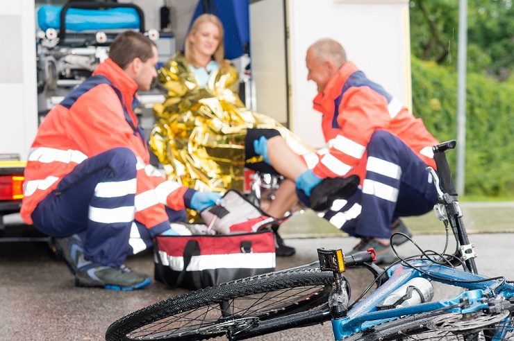 Accident bike woman get emergency help paramedics